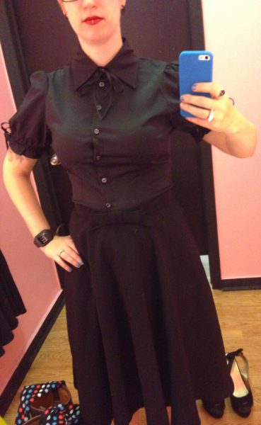 Here's when the shopgirl starting bringing me size small items instead of M. This blouse is awful. It is so not my style, and it gapes at the buttons. You can't tell in the photo, but the skirt was so small I couldn't zip it up all the way. It's open about 5 inches in the back.