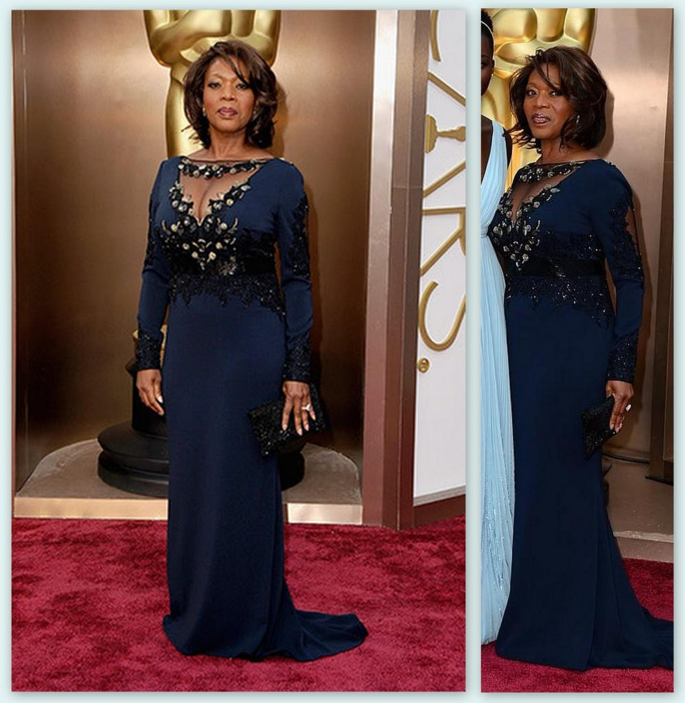 Alfre Woodard in Escada, with the most amazing posture. The image on the right shows a little of the cutout sleeves.