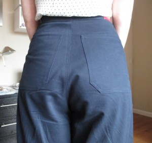 The back has a pair of long, high-placed pockets.