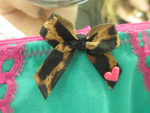 A closeup of Nichole's sweet little bow with a teeny tiny heart. Love it!