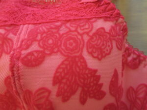A closeup of Mae's modern floral velvet print.