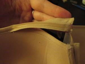 First I used a seam ripper to pick out the seam holding the upper cup trim in place. Don't cut off the excess trim, as you'll be re-attaching it later.