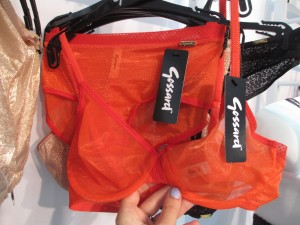 """I've read mixed reviews of the """"Glossies"""" bras, but obviously I was attracted to this orangey """"fiesta red"""" colorway. The fabric felt surprisingly soft and smooth despite its acrylic look. Definitely worth a try. Coming out in May."""