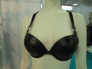 Oh my god it's a faux leather bra with suspender-style details!