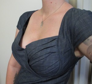 I use fashion tape to hold the panels together (pictured here), and another strip on my right boob to keep the fabric from floating away from my chest so much (not pictured here).