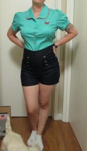 Tucked into high-waist shorts.