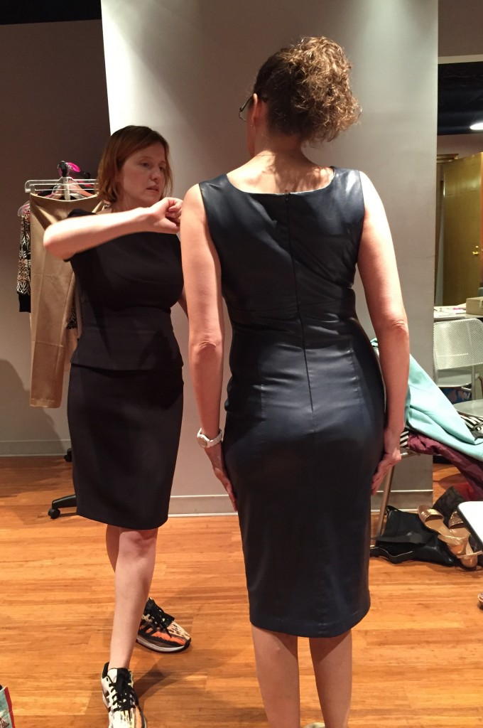 dd atelier olga adjusting pleather dress on donna