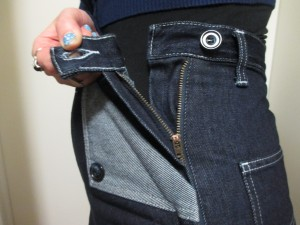 The zipper is on the side seam, instead of hidden inside the pocket like the New Jeanies, with one button.