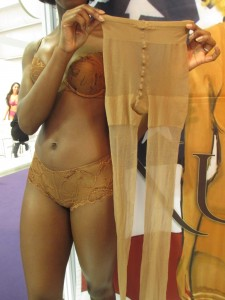 And the same tights after the stretching, being held by a model in the Classic Lace Boost Bra and Classic Lace Short.