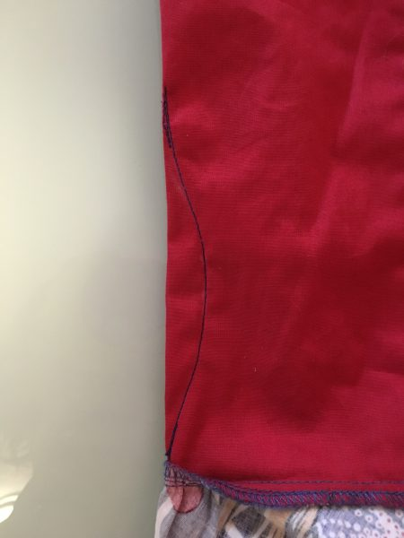 Then you simply sew along the chalk line. Try to keep the ends of the sewn line as close to the fabric edge as possible so that you don't end up with little bubbles on the exterior. (Apologies that this photo is actually the backside instead of the chalked side, but you get the idea.)