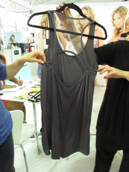 """The romper (or """"playsuit,"""" as they call it) features a fishnet racerback complete with cutout."""