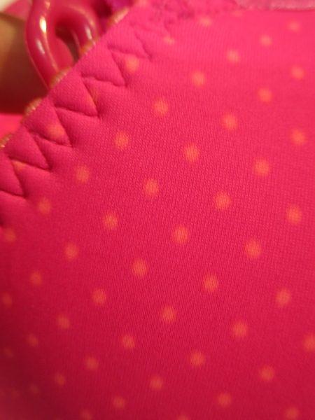 A closeup of the orange dot print on Smoothie Soul.