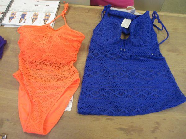 Sundance is back in a fabulous neon orange and royal blue. The collection now includes an all-lace tankini with sheer body below the bust (starts at 30, up to GG).