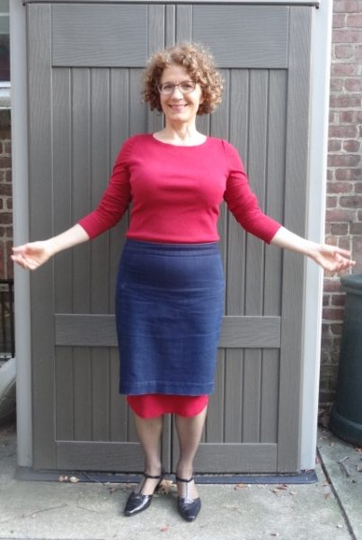 red-dress-peeping-from-under-denim-skirt