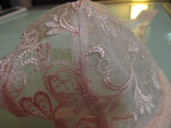 Here, you can see the difference between the upper cup (left side of the seam) and the tulle-lined lower cup (right side).