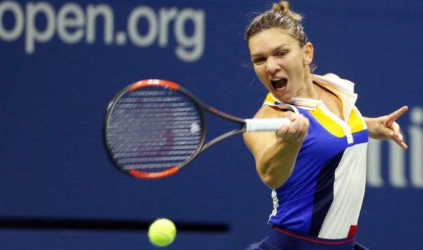 Simona Halep, of Romania hits against Mari Sharapova during the opening round of the U.S. Open tennis tournament in New York, Monday, Aug. 28, 2017. (AP Photo/Kathy Willens)