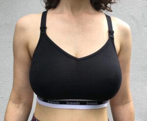 White woman wearing black sports-bra style nursing bra