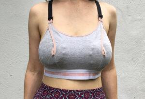 White woman wearing Clip and Pump bra fastened to a regular nursing bra
