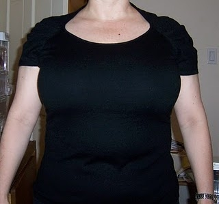 large chest spotlighted via cap sleeves